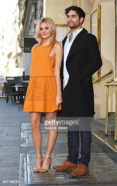 Cast members Pixie Lott and Charlie De Melo pose at a photocall for a new stage adaptation of Truman Capote's 'Breakfast at Tiffany's' at the Theatre...
