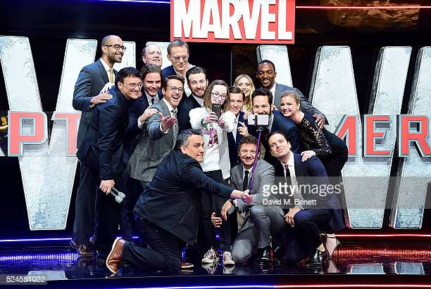 Cast members pose with competition winner Lottie French for a selfie during the European Premiere of 'Captain America Civil War' at Vue Westfield on...