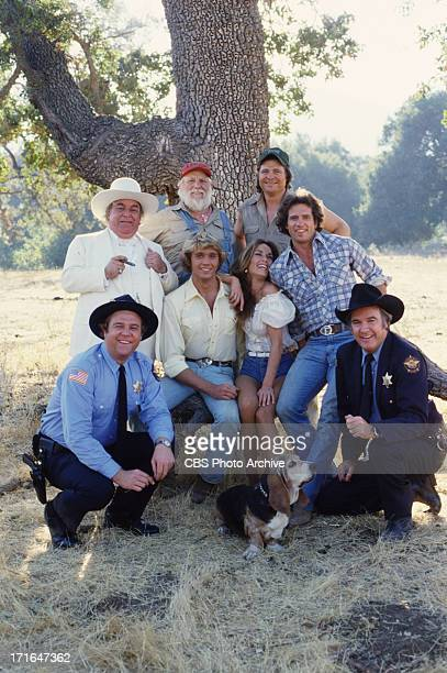HAZZARD cast members Rick Hurst John Schneider Catherine Bach Tom Wopat and James Best Basset hound Sandy Back row from left Sorrell Booke as...
