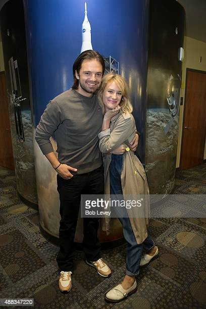 Cast members Sebastian Stan and Mackenzie Davis pose for photos during a NASA Roundtable Cast Members Of 'The Martian' at Lyndon B Johnson Space...