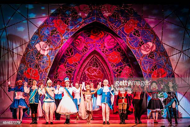 Cast members take a bow after performing the Puss in Boots pantomime at the Hackney Empire on December 6 2013 in London England