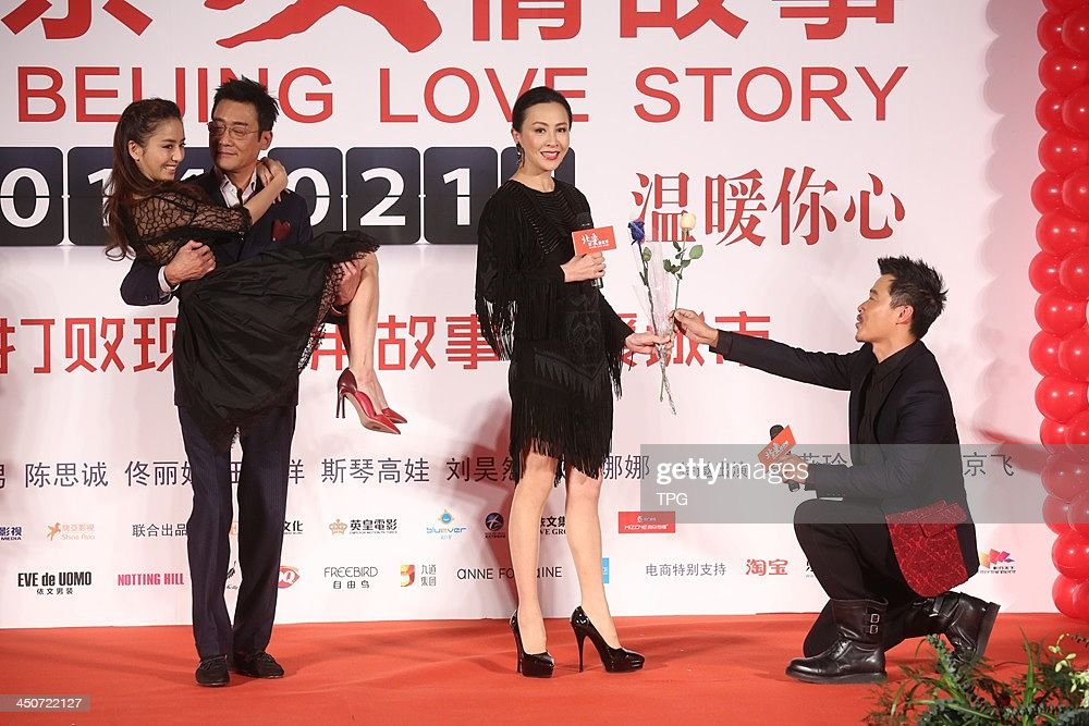 Cast members Tong Liya(L-R),Tony Leung,Carina Lau and director Chen Sicheng attend press conference of Beijing Love Story on Tuesday November 19,2013 in Hong Kong,China.