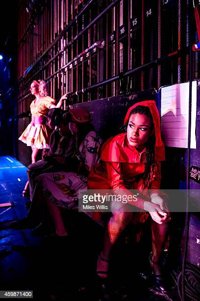 Cast members wait stage left during a performance of Mother Goose at Hackney Empire on December 2 2014 in London England