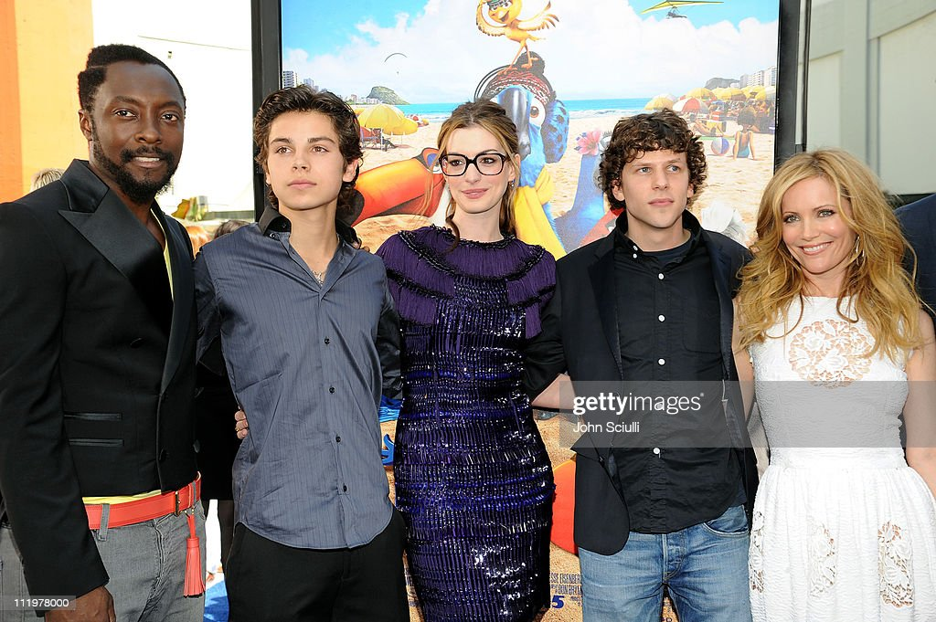 Cast members will.i.am, <a gi-track='captionPersonalityLinkClicked' href=/galleries/search?phrase=Jake+T.+Austin&family=editorial&specificpeople=709221 ng-click='$event.stopPropagation()'>Jake T. Austin</a>, <a gi-track='captionPersonalityLinkClicked' href=/galleries/search?phrase=Anne+Hathaway+-+Actress&family=editorial&specificpeople=11647173 ng-click='$event.stopPropagation()'>Anne Hathaway</a>, <a gi-track='captionPersonalityLinkClicked' href=/galleries/search?phrase=Jesse+Eisenberg&family=editorial&specificpeople=625439 ng-click='$event.stopPropagation()'>Jesse Eisenberg</a> and <a gi-track='captionPersonalityLinkClicked' href=/galleries/search?phrase=Leslie+Mann&family=editorial&specificpeople=595973 ng-click='$event.stopPropagation()'>Leslie Mann</a> arrive for the premiere of Twentieth Century Fox & Blue Sky Studios' 'RIO' on April 10, 2011 in Hollywood, California.