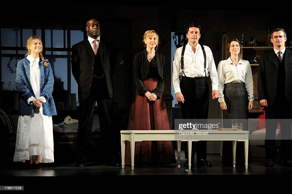 Cast members Yolanda Kettle, Steve Toussaint, Hattie Morahan, Dominic Rowan, Caroline Martin and Nick Fletcher bow at the curtain call during the press night performance of 'A Doll's House' at the Duke Of Yorks Theatre on August 14, 2013 in London, England.