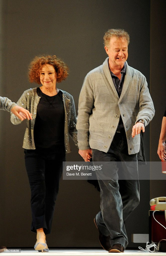 Cast members Zoe Wanamaker (L) and Owen Teale bow at the curtain call during the press night performance of 'Passion Play' at the Duke Of York's Theatre on May 7, 2013 in London, England.