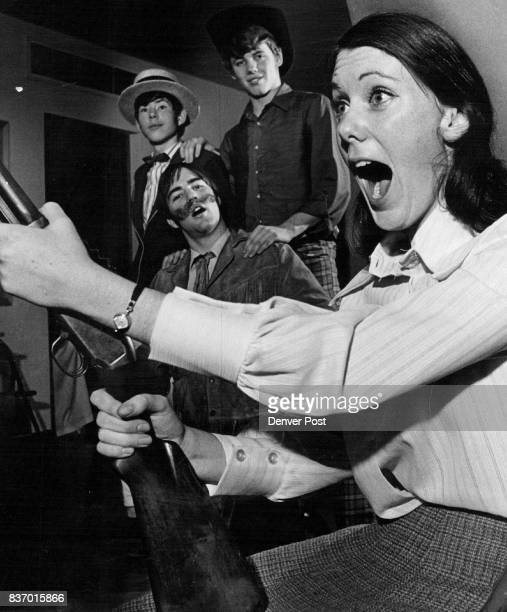 Cast of 'Annie get your Gun' join lustily in song Patty Seggelke as Annie Oakley and from left Steve Rollman Joe McEnerny Michael Keefe join in...