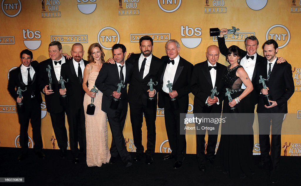 Cast of 'Argo' (L-R) Actor <a gi-track='captionPersonalityLinkClicked' href=/galleries/search?phrase=Chris+Messina&family=editorial&specificpeople=541094 ng-click='$event.stopPropagation()'>Chris Messina</a>, actor <a gi-track='captionPersonalityLinkClicked' href=/galleries/search?phrase=John+Goodman&family=editorial&specificpeople=207076 ng-click='$event.stopPropagation()'>John Goodman</a>, actor <a gi-track='captionPersonalityLinkClicked' href=/galleries/search?phrase=Bryan+Cranston&family=editorial&specificpeople=217768 ng-click='$event.stopPropagation()'>Bryan Cranston</a>, actor <a gi-track='captionPersonalityLinkClicked' href=/galleries/search?phrase=Kerry+Bishe&family=editorial&specificpeople=4584762 ng-click='$event.stopPropagation()'>Kerry Bishe</a>, actor <a gi-track='captionPersonalityLinkClicked' href=/galleries/search?phrase=Rory+Cochrane&family=editorial&specificpeople=210494 ng-click='$event.stopPropagation()'>Rory Cochrane</a>, actor/director <a gi-track='captionPersonalityLinkClicked' href=/galleries/search?phrase=Ben+Affleck&family=editorial&specificpeople=201856 ng-click='$event.stopPropagation()'>Ben Affleck</a>, actor <a gi-track='captionPersonalityLinkClicked' href=/galleries/search?phrase=Victor+Garber&family=editorial&specificpeople=208795 ng-click='$event.stopPropagation()'>Victor Garber</a>, actor <a gi-track='captionPersonalityLinkClicked' href=/galleries/search?phrase=Alan+Arkin&family=editorial&specificpeople=681109 ng-click='$event.stopPropagation()'>Alan Arkin</a>, actor Clea DuVall, actor <a gi-track='captionPersonalityLinkClicked' href=/galleries/search?phrase=Tate+Donovan&family=editorial&specificpeople=216433 ng-click='$event.stopPropagation()'>Tate Donovan</a>, and actor Christopher Denham pose in the press room at the 19th Annual Screen Actors Guild Awards held at The Shrine Auditorium on January 27, 2013 in Los Angeles, California.