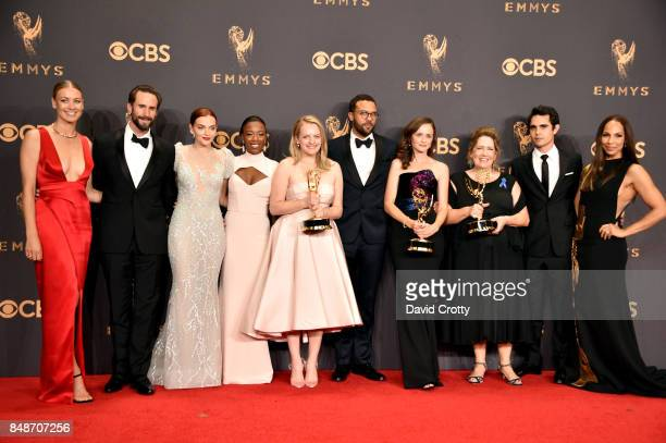 Cast of 'The Handmaid's Tale' winners of Outstanding Drama Series pose in the press room during the 69th Annual Primetime Emmy Awards at Microsoft...