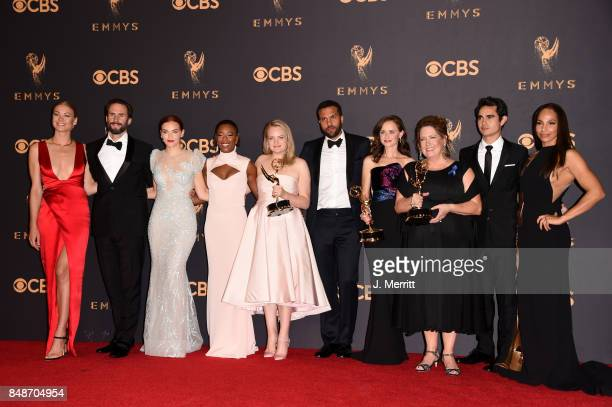 Cast of 'The Handmaid's Tale' winners of Outstanding Drama Series poses in the press room during the 69th Annual Primetime Emmy Awards at Microsoft...