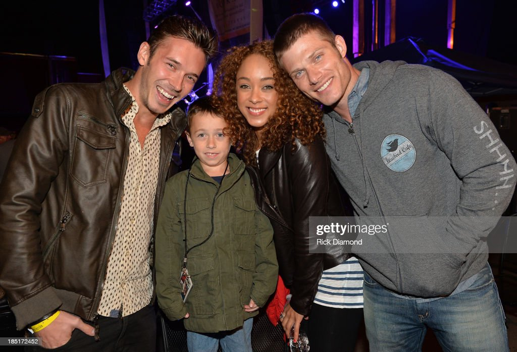 Cast of TV's Nashville, Actors <a gi-track='captionPersonalityLinkClicked' href=/galleries/search?phrase=Sam+Palladio&family=editorial&specificpeople=9149279 ng-click='$event.stopPropagation()'>Sam Palladio</a>, <a gi-track='captionPersonalityLinkClicked' href=/galleries/search?phrase=Chaley+Rose&family=editorial&specificpeople=10115530 ng-click='$event.stopPropagation()'>Chaley Rose</a> and <a gi-track='captionPersonalityLinkClicked' href=/galleries/search?phrase=Chris+Carmack&family=editorial&specificpeople=215274 ng-click='$event.stopPropagation()'>Chris Carmack</a> with 7 year old <a gi-track='captionPersonalityLinkClicked' href=/galleries/search?phrase=Kenny+Smith&family=editorial&specificpeople=221585 ng-click='$event.stopPropagation()'>Kenny Smith</a> who suffers from Crohns & Colitis disease attends the 16th annual Buds-n-Suds Music Festival a benifit for Crohns & Colitis Foundation of America (CCFA) Tennessee Chapterat at Losers Most Wanted Bar on October 17, 2013 in Nashville, Tennessee.