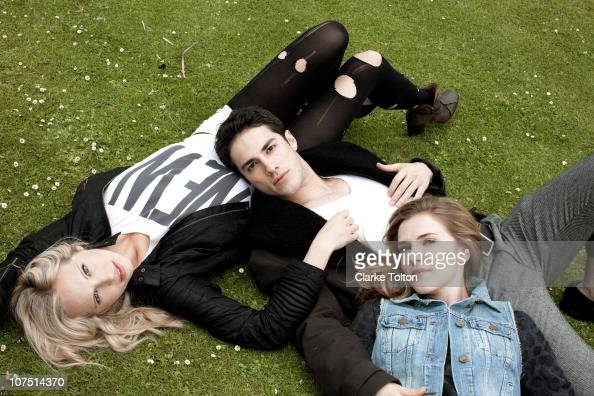 Cast of Vampire Diaries Candice Accola Sara Canning and Michael Trevino pose at a portrait session for Nylon Magazine on November 11 2010 in Los...