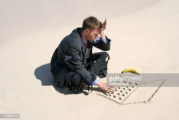 Castaway Businessman Frustrated at Work