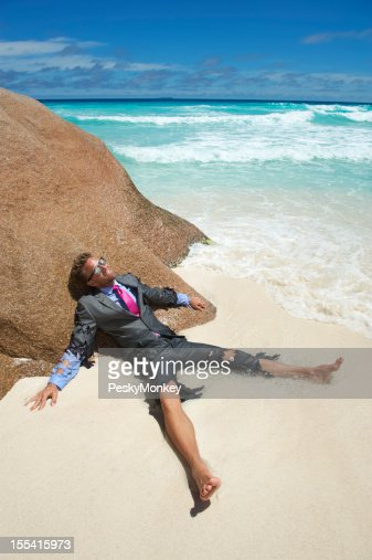 Castaway Businessman Lies Stranded on Tropical Beach