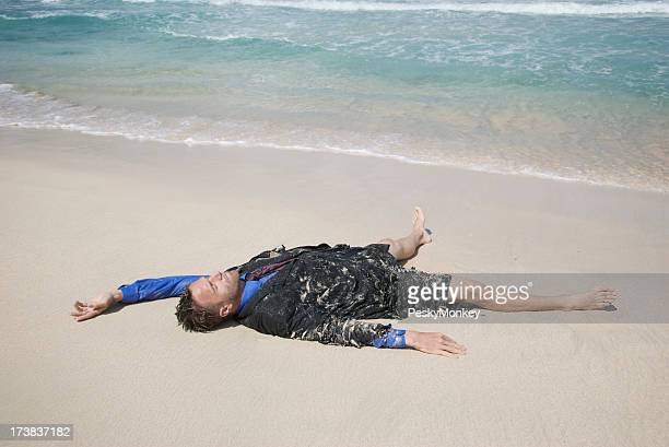 Castaway Businessman Passed Out on Beach