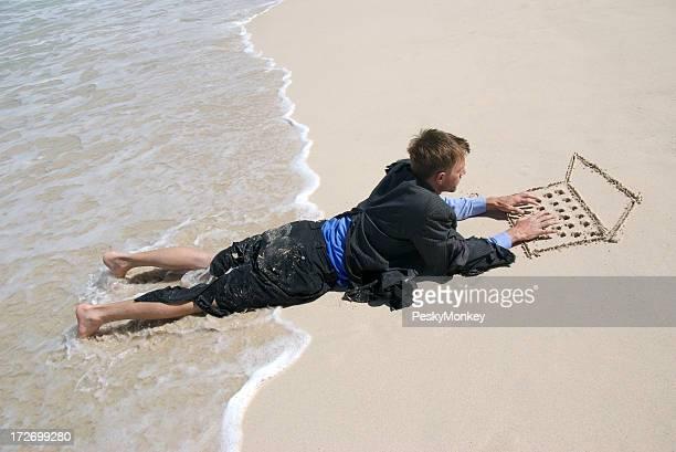 Castaway Businessman Types on Sand Laptop