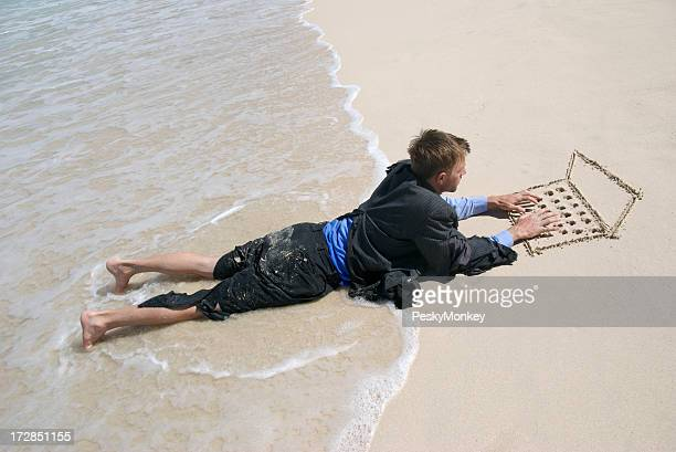 Castaway Businessman Typing on Sand Laptop in Waves