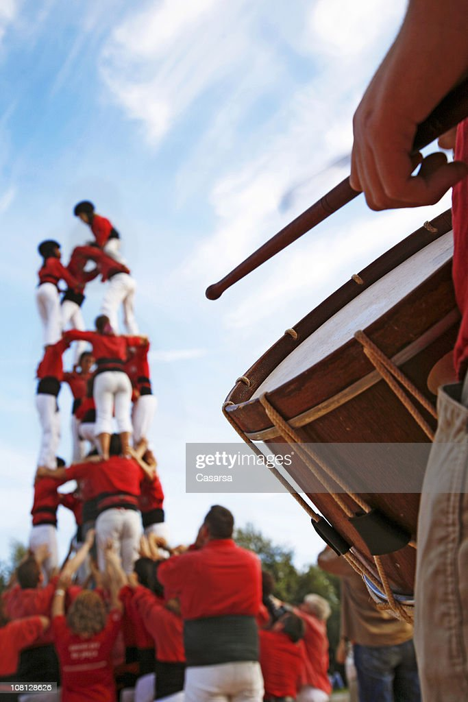 Castellers and Man Playing Drum on Sunny Day : Stock Photo
