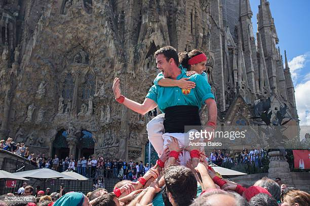 Castellers do their show in front of La Sagrada Familia in Barcelona on April 17 2016 Castells are a 200yearsold Catalan mainstream folklore and part...