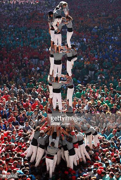 Castellers of the Castellers de Sants 'colle' build a human tower during the 22nd Tarragona Castells Competition on October 5 2008 in Tarragona Spain...
