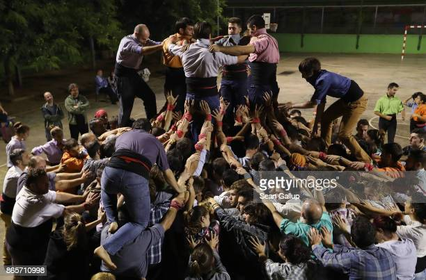 'Castellers' the term for members of the Castellers de Sants human tower group build a tower during an evening training session in the courtyard of a...