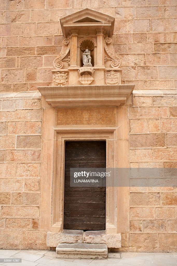 Castellon el Fadri tower door in Plaza Mayor square : Stock Photo