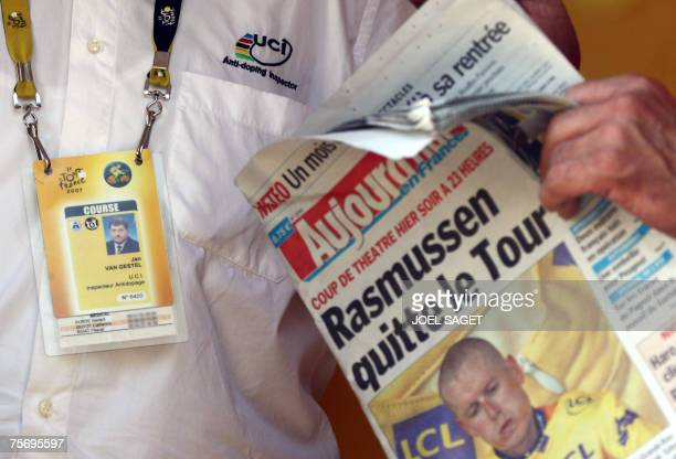 Picture shows an official reading today's newspaper reading 'Rasmussen leaves the Tour' while being with UCI antidoping inspector Jan Van Gestel in...