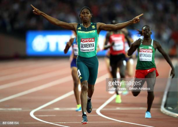 Caster Semenya of South Africa celebrates as she crosses the line ahead of Francine Niyonsaba of Burundi to win the Womens 800 metres final during...