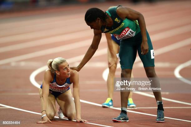 Caster Semenya of South Africa congatulates to Lynsey Sharp of Great Britain after competing the Women's 800 metres semi finals during day eight of...