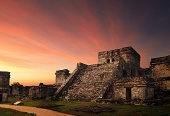 Castillo fortress at sunset in the ancient Mayan city of Tulum, Mexico