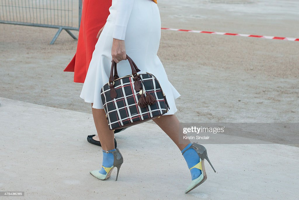 Casting Agent, Fashion Consultant Natalie Joos wears an Ellery skirt, Jimmy Choo shoes and Brahmin bag on day 3 of Paris Collections: Women on February 27, 2014 in Paris, France.