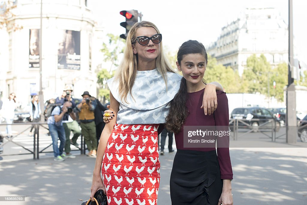 Casting director Natalie Joos wearing A.W.A.K.E top, skirt and bag and Tom Ford sunglasses with Natalia Alaverdian wearing a Miu Miu dress and a Dolce and Gabanna bag on day 9 of Paris Fashion Week Spring/Summer 2014, Paris October 02, 2013 in Paris, France.