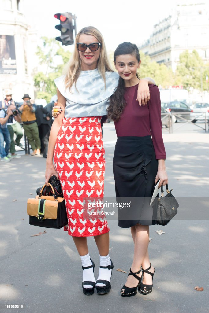 Casting director Natalie Joos wearing A.W.A.K.E top, skirt and bag, Dolce and Gabanna shoes and Tom Ford sunglasses with Natalia Alaverdian wearing YSL shoes, Miu Miu dress and a Dolce and Gabanna bag on day 9 of Paris Fashion Week Spring/Summer 2014, Paris October 02, 2013 in Paris, France.