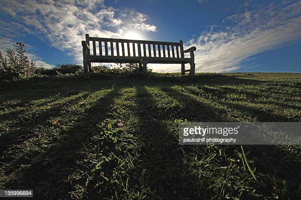 Casting shadows on bench at Beachy Head