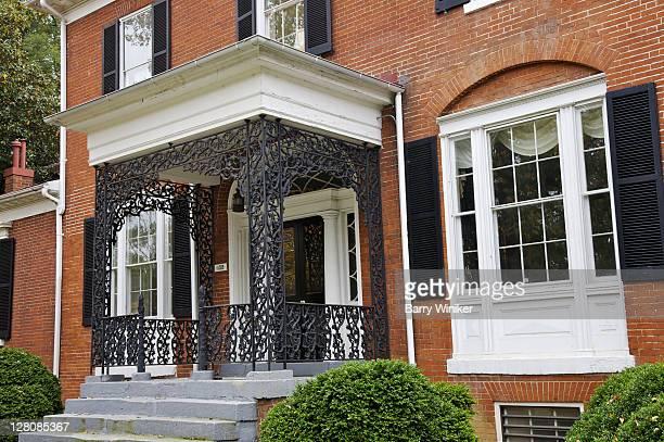 Castiron decorative rails on porch of residence in Fredericksburg, VA, U.S.A.