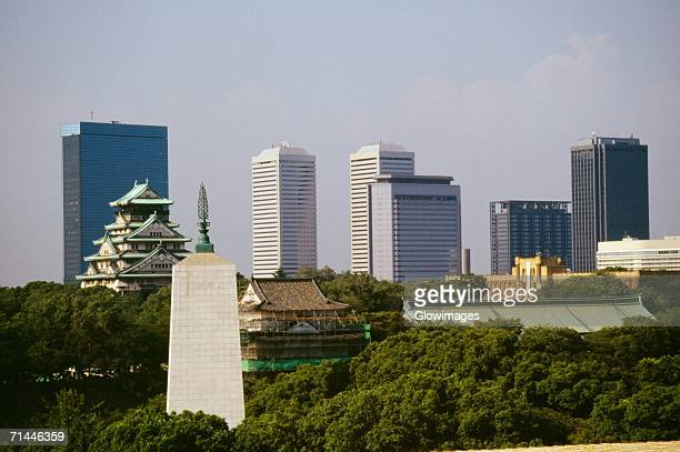 Castle and skyscrapers in a city, Osaka Castle, Osaka, Japan