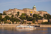 Castle Hill with cruise boat sailing down the Danube River.