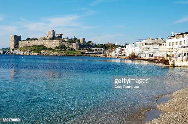 Castle of St Peter, whitewashed houses and beach.