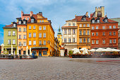 Castle Square, Piwna street and Bell tower of St. Martin's Church in the morning, Warsaw Old town, Poland.