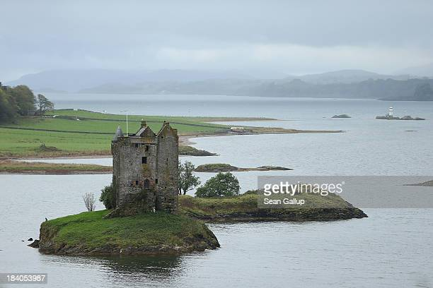 Castle Stalker stands at Loch Linnhe on October 7 2013 near Glencoe Scotland The Highlands of Scotland are a popular tourist destination