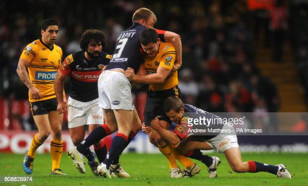 Castleford Tigers' Brett Ferres is tackled by Wakefield Trinity Wildcats' Aaron Murphy and Sam Orbst during the Engage Super League match at the...