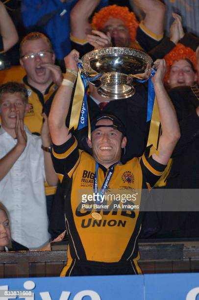 Castleford Tigers' captain Andrew Henderson lifts National League 1 cup during the Cooperative National League One Final at Headingley Carnegie...