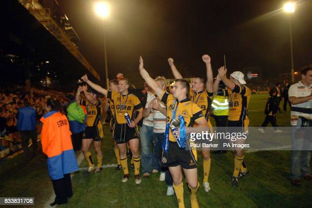 Castleford Tigers celebrate winning the National League 1 cup during the Cooperative National League One Final at Headingley Carnegie Stadium Leeds