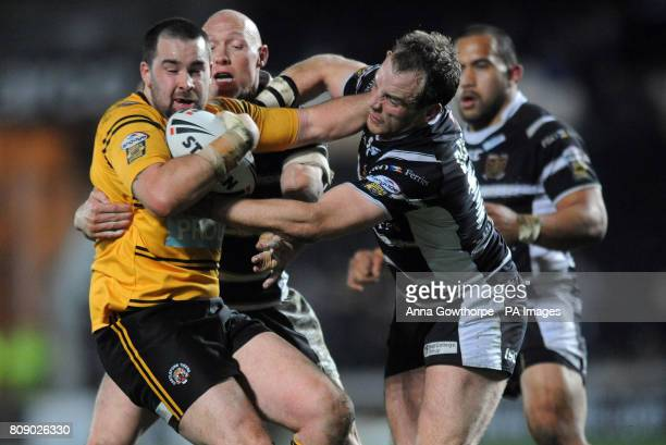 Castleford Tigers' Craig Huby is tackled by Hull FC's Craig Fitzgibbon and Ewan Dowes during the engage Super League match at the KC Stadium Hull