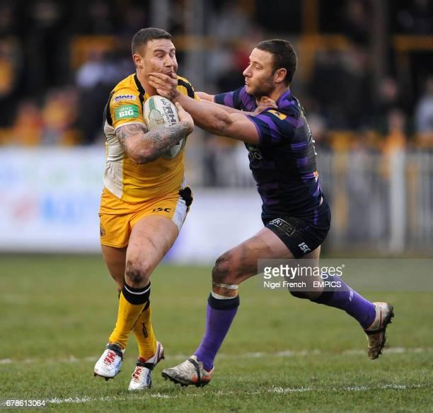 Castleford Tigers' Jamie Ellis is tackled by Wigan Warriors' Blake Green