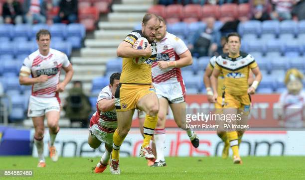 Castleford Tigers Liam Finn is tackled by Wigan Warriors Ben Flower during the Tetley's Challenge Cup Quarter Final match at the DW Stadium Wigan