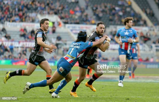 Castleford Tigers' Luke Gale is tackled by Leeds Rhinos Ash Golding during day two of the Betfred Super League Magic Weekend at St James' Park...