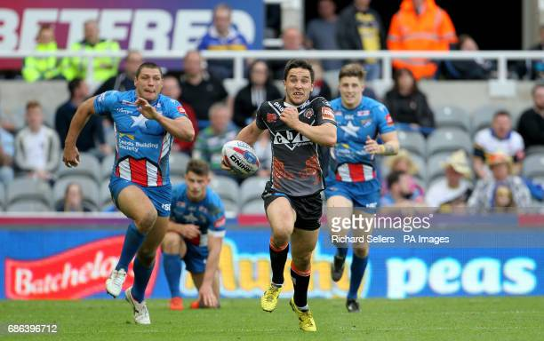 Castleford Tigers' Tom Holmes runs the length of the pitch to score a try during day two of the Betfred Super League Magic Weekend at St James' Park...