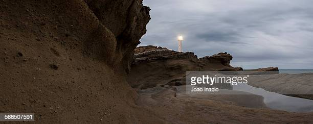 Castlepoint Lighthouse shines its light at night