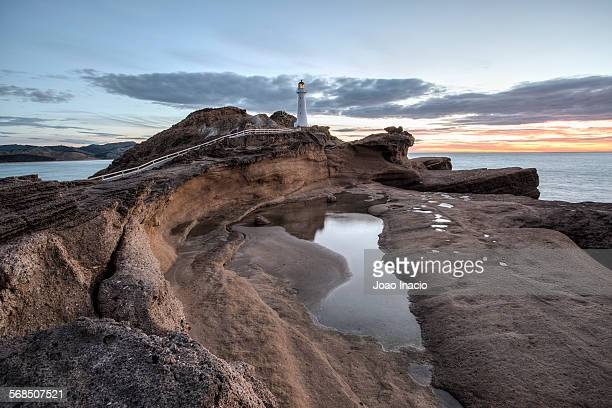 Castlepoint Lighthouse shines its light at sunrise